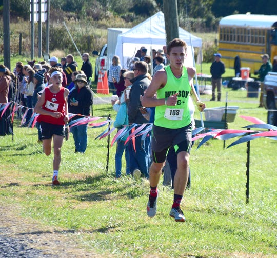 Wilson Memorial's Vincent Leo moves ahead of East Rockingham's George Austin III during the final mile of the boys race at the VHSL Class 2, Region B Cross Country Championships on Tuesday, Oct. 30, 2018, at New Market Battlefield Park in New Market, Va.