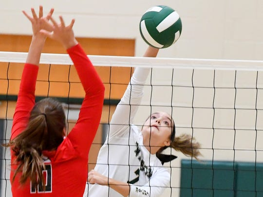 Wilson Memorial's Olivia Bower hits the ball back over the net across from East Rockingham's Sage Fox during a Shenandoah District championship match played in Fishersville on Monday, October 29, 2018.