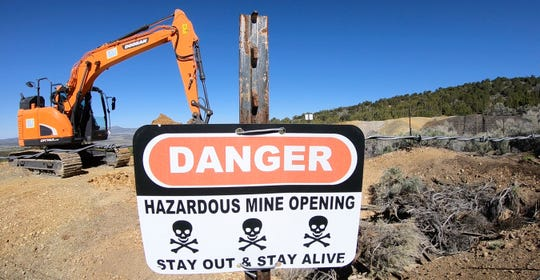 A mine shaft is covered near Eureka. Utah is trying to seal more than 10,000 open mines after people have died from rock falls, ATV crashes and poisonous air.