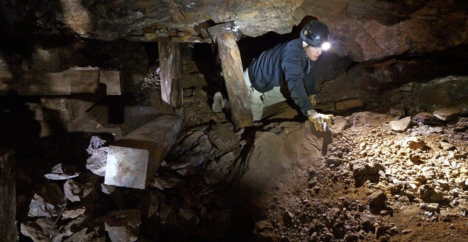 Jeremy MacLee explores a mine near Eureka on Aug. 26, 2018.