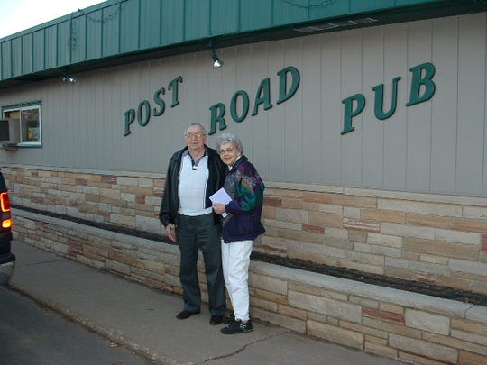 Albert and Bette Zurawski in front of Post Road Pub in Plover