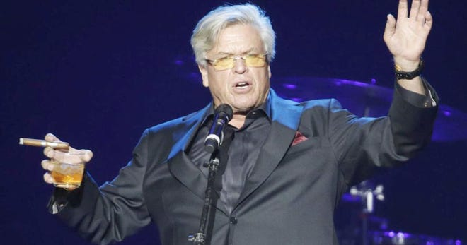 Comic Ron White is never too far from a lit stogie and a glass of hooch in concert.
