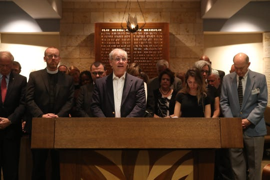 Surrounded by other area clergy, Rabbi Jack Romberg addresses the congregation gathered at Temple Israel in Tallahassee, Fla. Monday, Oct. 29, 2018, during a service honoring the lives of the victims of the shooting at Tree of Life Synagogue in Pittsburgh, Pa.