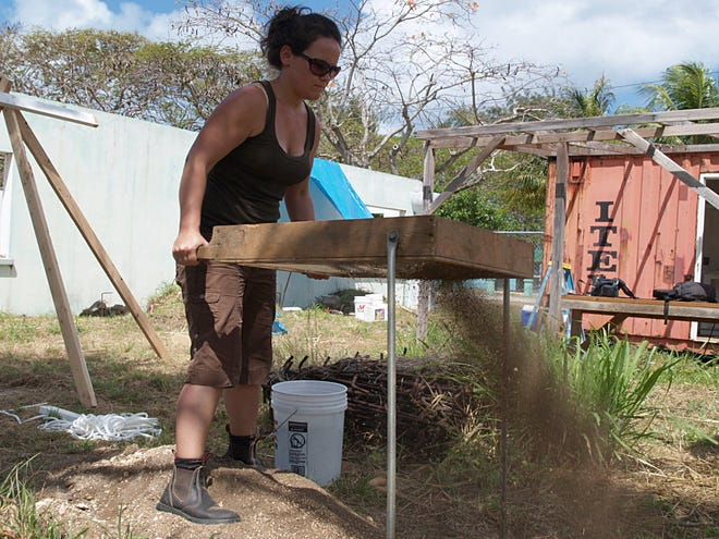 Archaeologist Jennifer McKinnon screens soil for artifacts on the island of Saipan in the Northern Mariana Islands.