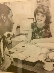 An old photo of Andrew Gillum talking with Linda Awbrey, a mentor back from his days at Gainesville High School.