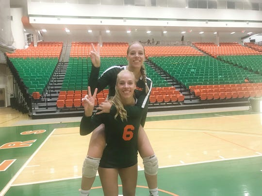 FAMU volleyball twins Radka (6) and Elena Dimitrova celebrate a recent victory in the Al Lawson Center Multipurpose Center.