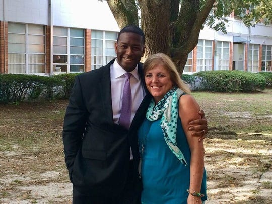 Andrew Gillum poses for a photo with Linda Awbrey, a mentor back from his days at Gainesville High School.