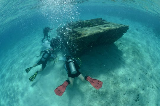 Archaeological Jennifer McKinnon and her team investigating a U.S. amphibious landing craft in the waters of Saipan in the Northern Mariana Islands.