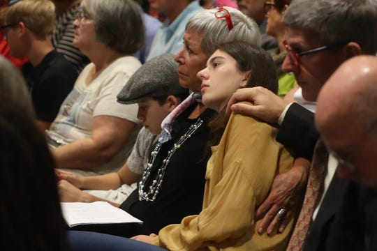 An attendee spends a moment in prayer during a service honoring the lives of the victims of the shooting at Tree of Life Synagogue in Pittsburgh, Pa. held at Temple Israel in Tallahassee, Fla. Monday, Oct. 29, 2018.