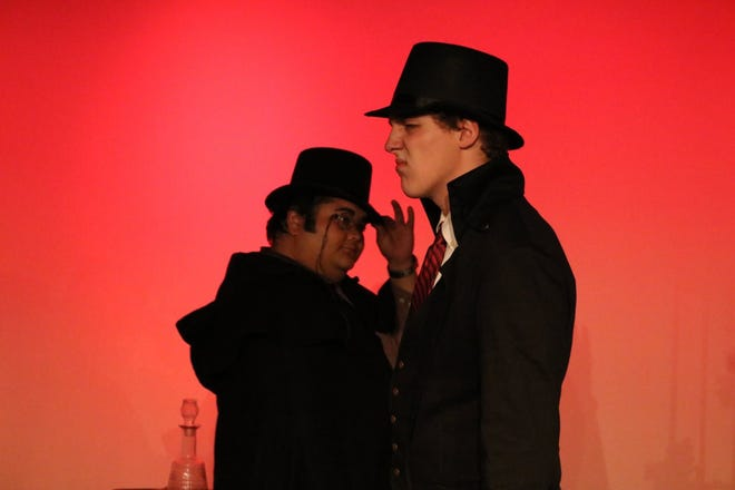 """Hyde 3 (Andrew Falls) and Dr. Carew (Larry Blake) pass each other in the park in TOSAC's production of """"Dr. Jekyll and Mr. Hyde."""""""