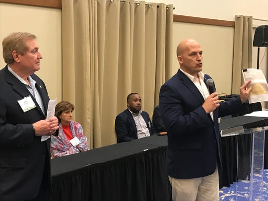 Port St. Lucie Mayor Oravec addresses an audience of real estate and development professionals Oct. 29, 2018 during a welcome reception for a team of planners assembled by the Urban Land Institute. John Walsh (left), of TIG Real Estate Services, is the chair of the panel.