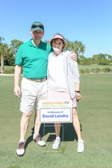 Sarah's Kitchen Founder Bob Carey and Nancy Landry honor Founder Dave Landry at the Be a Hunger Hero golf tournament.
