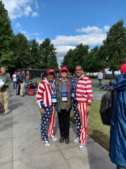 Dr. Shamsher Singh, left, flew on his 25th Honor Flight on Oct. 13, shown here with Fort Pierce Mayor Linda Hudson, and Singh's son, Rohit Singh, who now has a matching uniform and shoes.