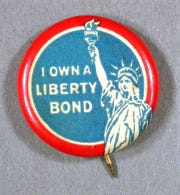 Pin worn proudly by those who purchased Liberty Bonds. Pin-back, I Own A Liberty Bond, ca 1917-1918. 2006.0098.0310. Perlov Celluloid Collection.