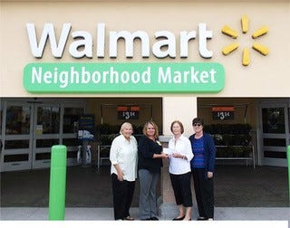 Back To Basics Angels Chair Barbara Pray, left, Walmart Manager Susan Schrenk, Holy Family Council of Catholic Women President Carole Inzirillo and Vice President Elizabeth Walters.