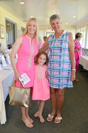 "Cindy and Harper Diovisalvi, left, with Bonnie Bohannan at the Friendship Luncheon ""Positively Pink"" on Oct. 20 at the Legacy Golf & Tennis Club in Port St. Lucie."
