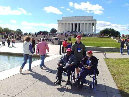 Southeast Florida Honor Flight guardian Michael Hudson, center, with veterans David Smith, left, and  Harold Sterenberg, in front of the Lincoln Memorial on Oct. 13.