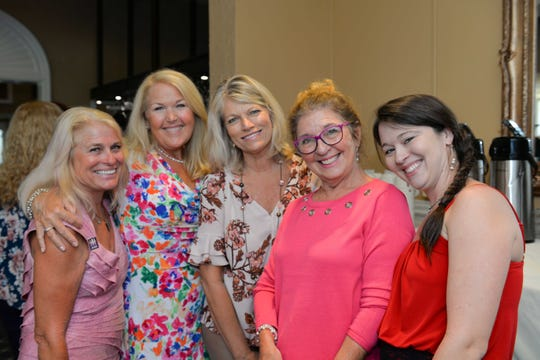 "Gail McCallum, left, Linda Clark, Anne Ellig, Jenny McCarty and Mary Ellen McLoughlin at the Friendship Luncheon ""Positively Pink"" on Oct. 20 at the Legacy Golf & Tennis Club in Port St. Lucie."