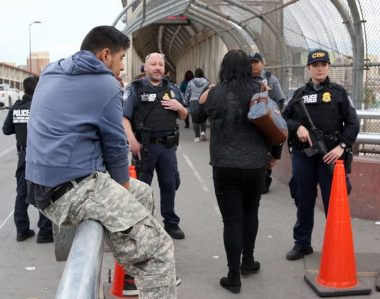 U.S. Customs and Border Protection officers check documents on border crossers at the summit of the Paso Del Norte international bridge in October 2018.