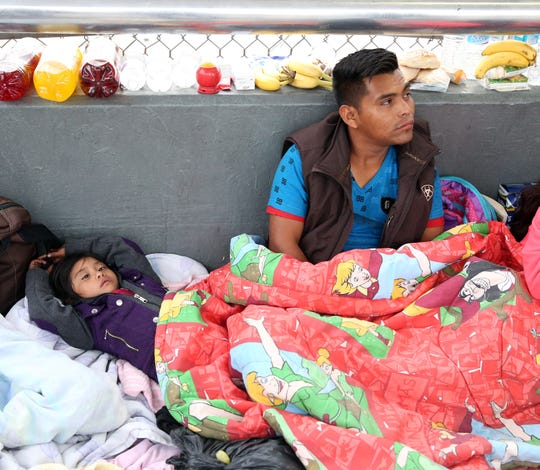 Guatemalan Victor Vasquez Morales, right, and his 6-year-old daughter were among a group of migrants camped on the Mexican side of the Paso Del Norte international bridge in hopes of entering the U.S.