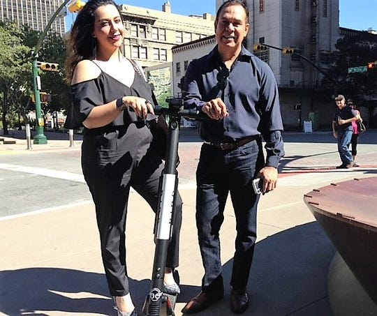 El Pasoans Dorali Licon and Hugo Saldana prepare to ride a Bird electric scooter Oct. 26 near the Mills Building in Downtown El Paso.