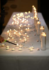 Eleven candles were set up for the 11 victims of the Pittsburgh synagogue shooting in the lobby of the Temple Etz Chaim in Thousand Oaks for a special solidarity service on Monday night.
