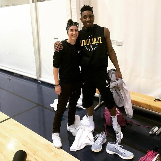 Sidney Dobner, left, takes a photo with Utah Jazz star Donovan Mitchell.