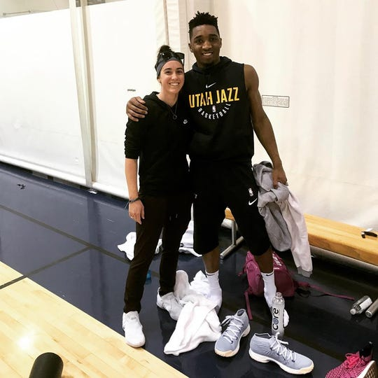 Sidney Dobner, left, takes a photo with Utah Jazz star Donovan Mitchell.
