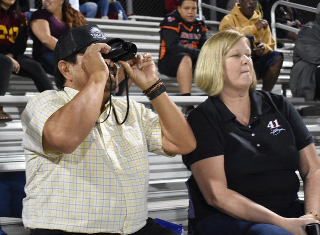 Alfredo and Pam Lira watch Alfredo's son play for Buena High School in a game against Oxnard High. They support his choice to play but wince each time he's hit.