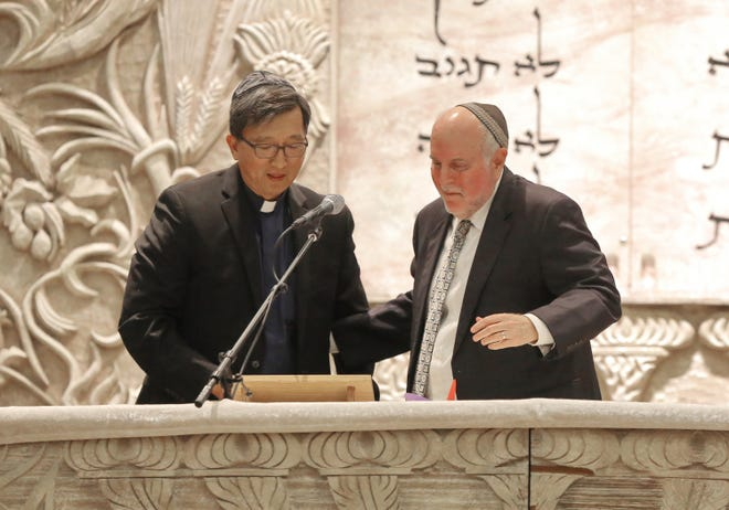 United Methodist Church of Thousand Oaks Senior Pastor John Yoon is greeted by Temple Etz Chaim Rabbi Richard Spiegel during a solidarity service for the victims of the Pittsburgh synagogue shooting. The United Methodist Church and Temple Etz Chaim share the same property in Thousand Oaks and have a close relationship. People from all faiths attended the service.