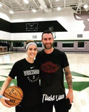 Sidney Dobner, left, takes a photo with singer Adam Levine.