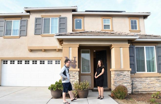 Visalia realtor Karol Anderson meets prospective homebuyer Michael Chenung in the up-and-coming Oak Grove neighborhood.