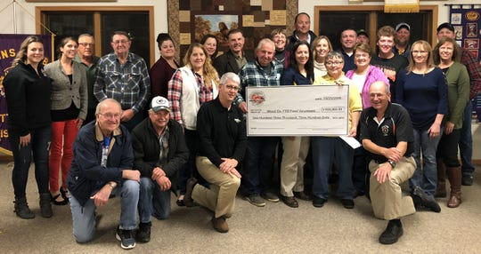 FTD Host Ken Heiman and Chairman Dennis Bangart presented a check to the Marshfield Columbus High School Athletic Program for their help with parking cars at Farm Technology Days.