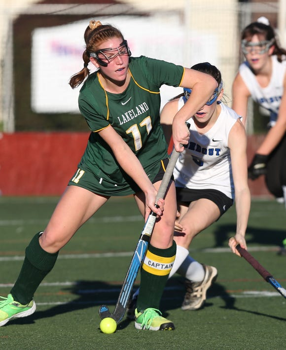 From left, Lakeland's Julianna Cappello (11) moves the ball away from Rondout Valley's Julie Ruzzi (5) during the Class B  field hockey regional semifinal at Dietz Stadium in Kingston on Oct. 30. Lakeland won the game 4-1.