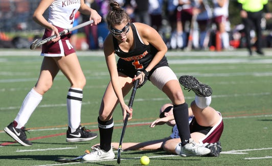 Mamaroneck's Brigid Knowles (1) fires a shot against Kingston during the field hockey Class A regional semifinal at Dietz Stadium in Kingston Oct. 30, 2018.