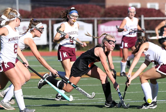 Mamaroneck's Elizabeth Brissette (6) gets off a pass while surrounded by Kingston defenders during the field hockey Class A regional semifinal at Dietz Stadium in Kingston Oct. 30, 2018.