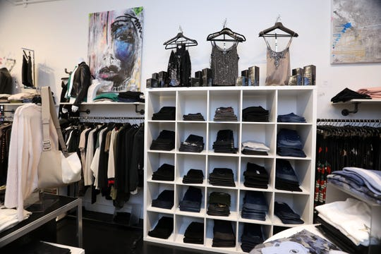 Clothing and accessories at I Am More, a women's clothing boutique that supports women-owned designers and gives back to women's philanthropic organizations, in Scarsdale Oct. 29, 2018.