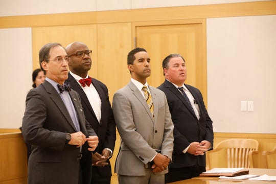 Mayor Richard Thomas appears in court with his attorneys Ben Kuehne, Anthony Ricco and Michael Pizzi, at the Westchester County Courthouse in White Plains on Oct. 30, 2018.