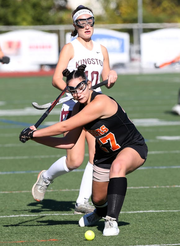 Mamaroneck's Erin Cotter (27)) fires a shot against Kingston during the field hockey Class A regional semifinal at Dietz Stadium in Kingston Oct. 30, 2018.
