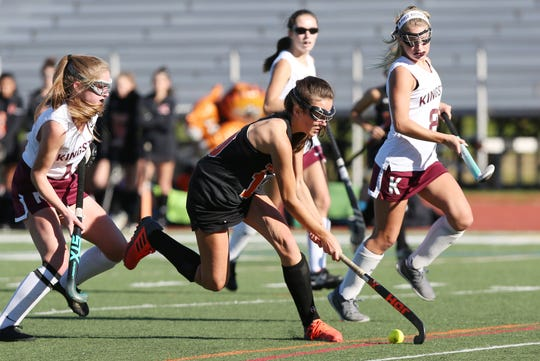 Mamaroneck's Laine Pearson (10) moves the ball up the field against Kingston during the field hockey Class A regional semifinal at Dietz Stadium in Kingston Oct. 30, 2018.