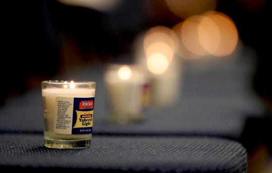 Eleven memorial candles were lit in honor of those killed in the fatal shooting at a Pittsburgh synagogue Saturday during a vigil at JCC Rockland in West Nyack Oct. 29, 2018.