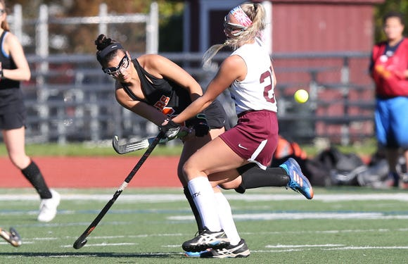 Mamaroneck's 's  Margo Payne(26) gets a pass around Kingston's Riley Fitzgerald (27) during the field hockey Class A regional semifinal at Dietz Stadium in Kingston Oct. 30, 2018.