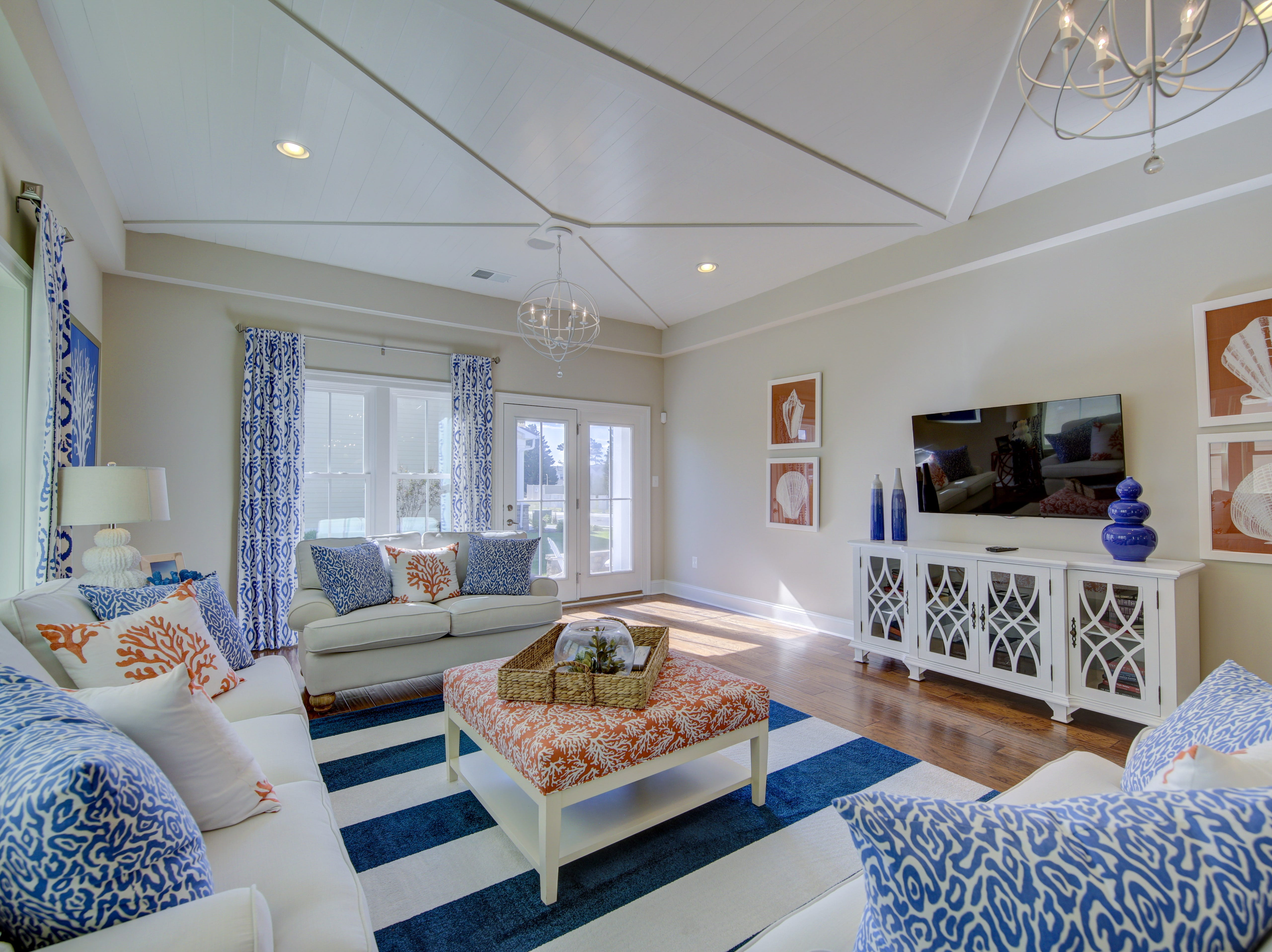 The living area in the model home in the Overlook in Selbyville has a custom ceiling with decorative moldings.
