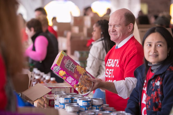 Sen. Chris Coons joins Chase employees as they pack more than 3,000 meal boxes for senior citizens for the Food Bank of Delaware. The Food Bank of Delaware distributes the boxes to community centers that serve seniors.