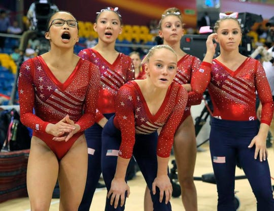 Team USA with Morgan Hurd (left) reacts after teammate Simone Biles' floor exercise during the women's team final of the Gymnastics World Championships at the Aspire Dome in Doha, Qatar, Tuesday, Oct. 30, 2018.
