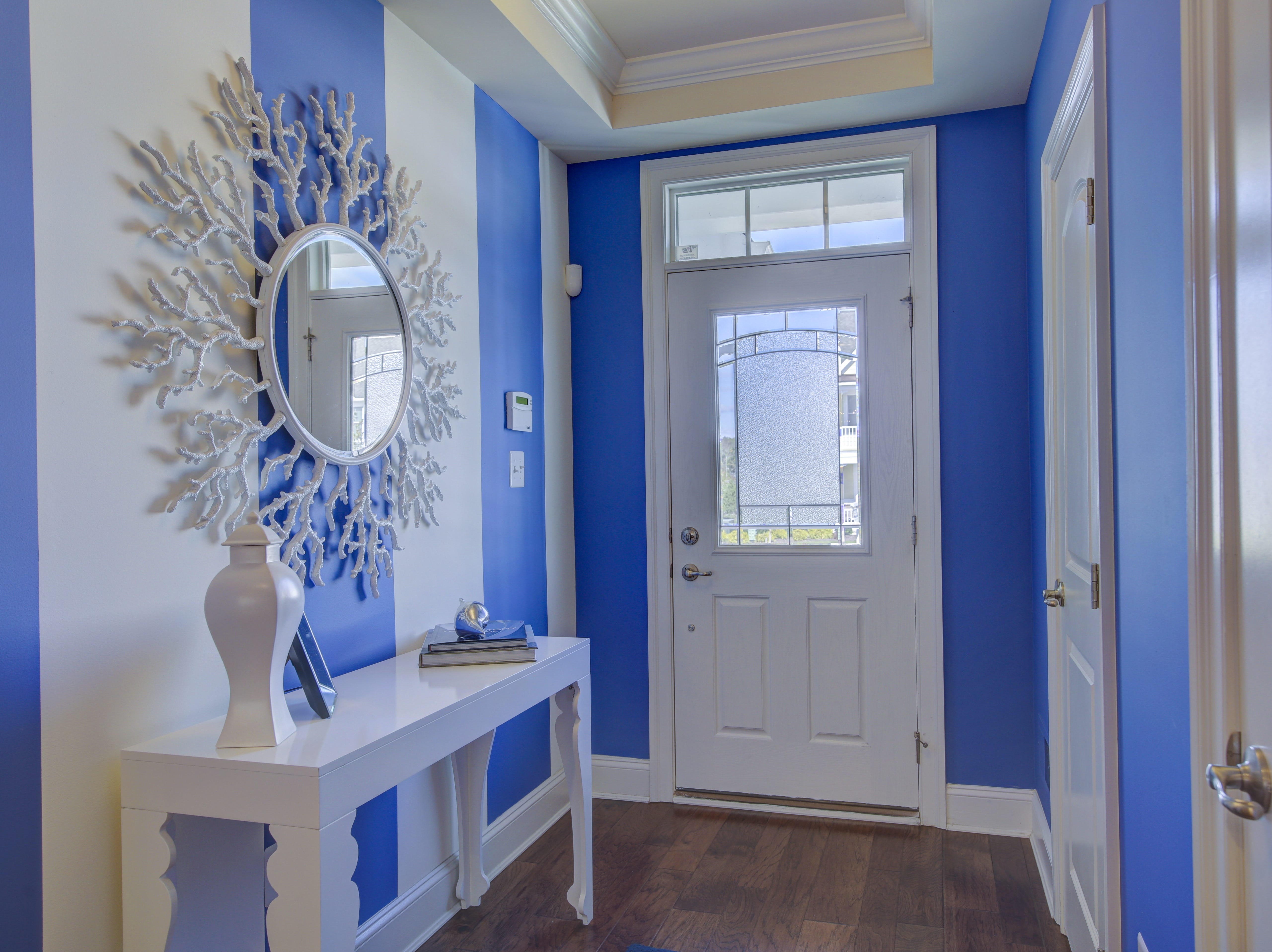 Blue and white striped walls in the foyer of the Overlook model in Selbyville are an extra.