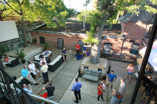 Patrons enjoying the patio behind Kelly's Logan House in 2013.
