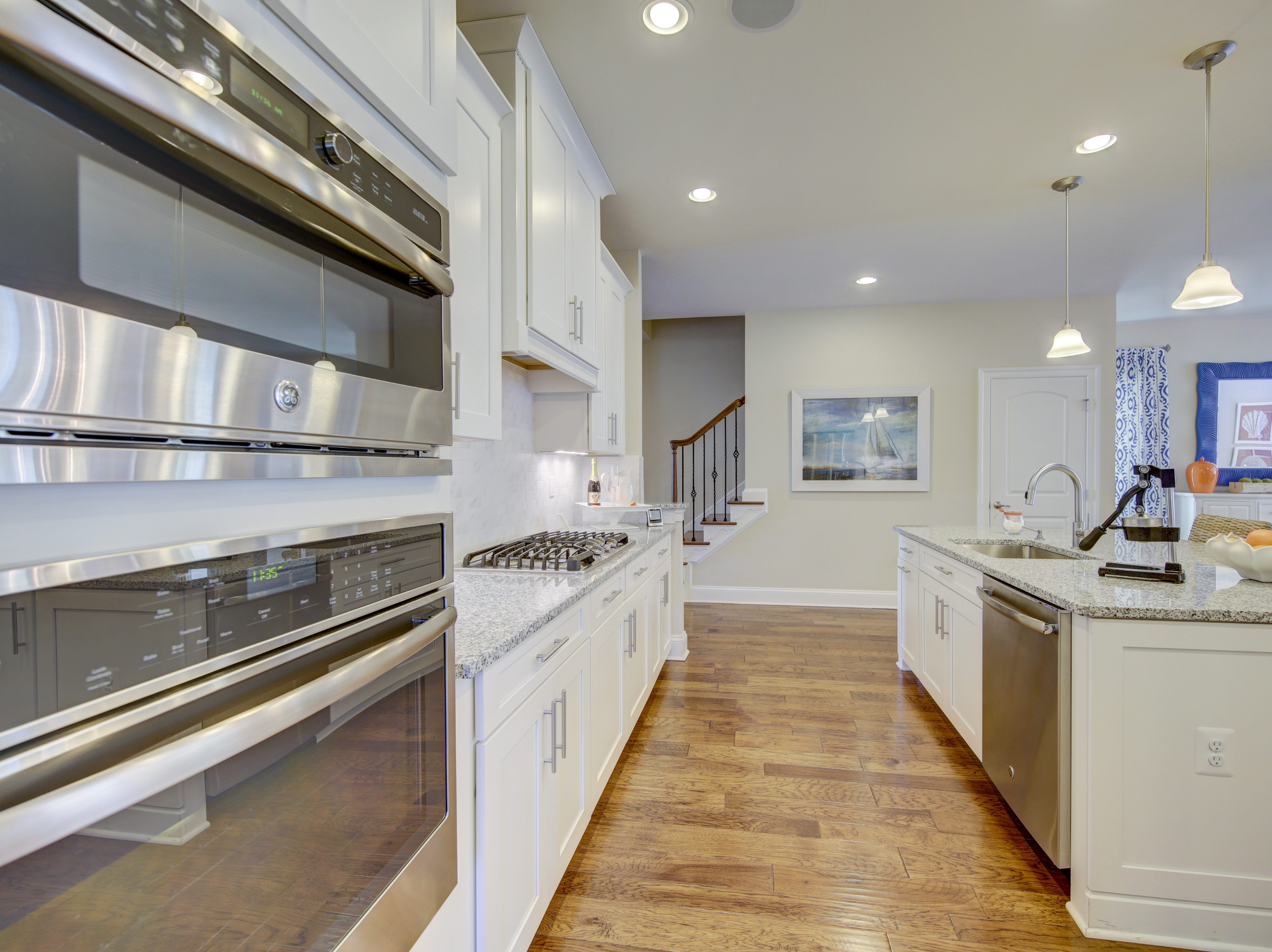 The kitchen of the model home in the Overlook at Selbyville has stainless steel appliances and a center island.