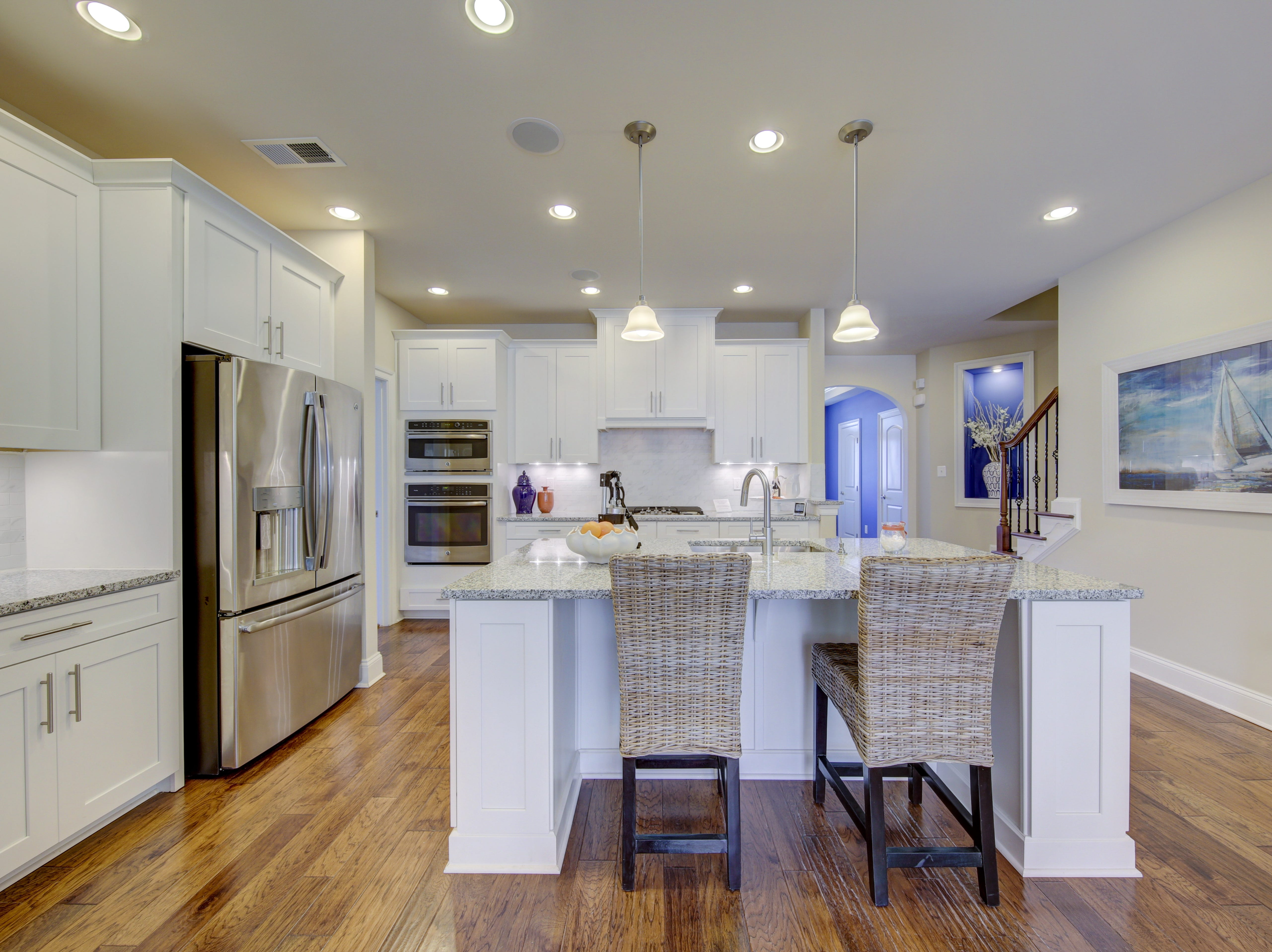 The kitchen in the model home of The Overlook in Selbyville has stainless steel appliances and a center island.