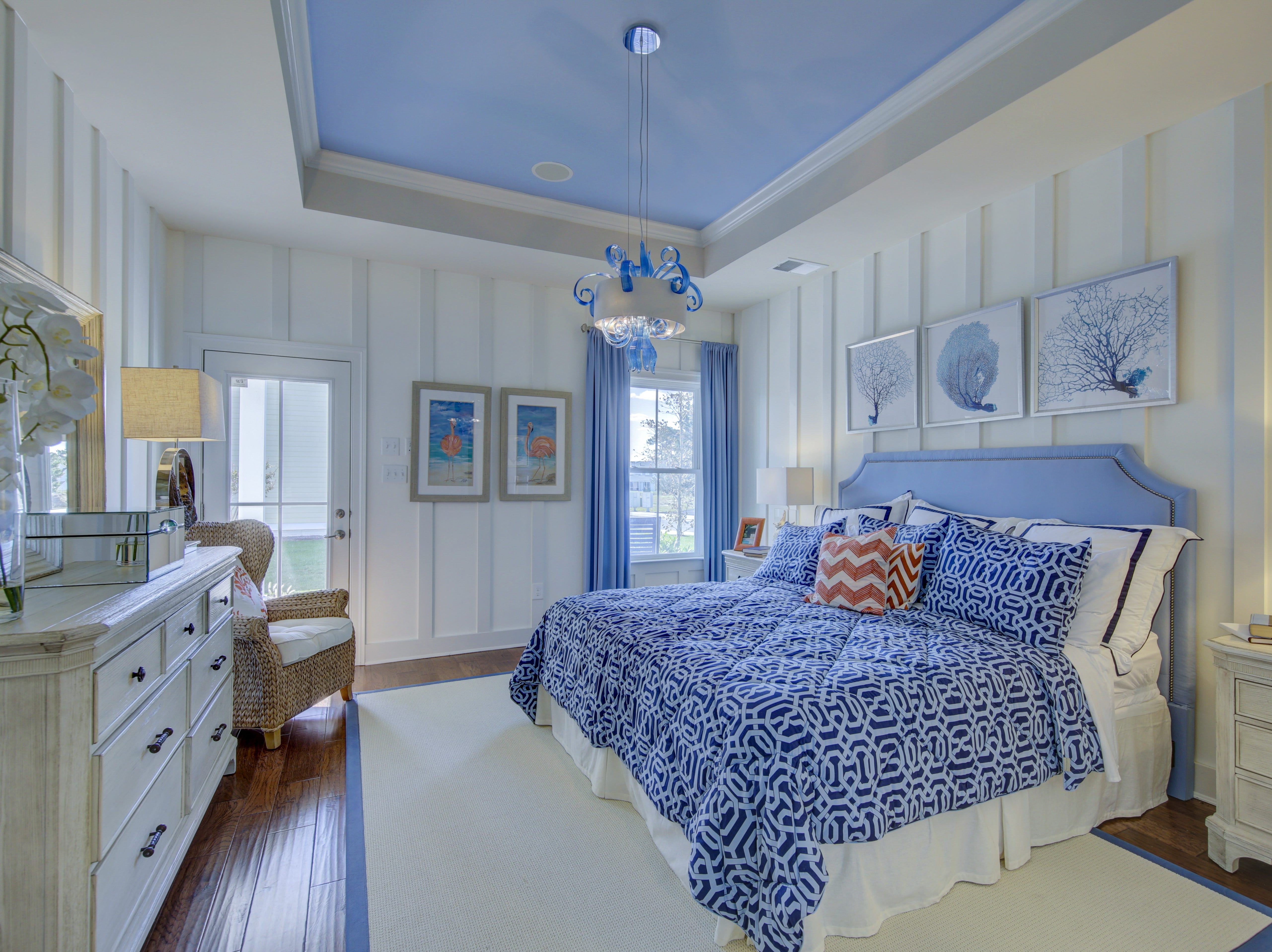The master bedroom in the model home at The Overlook in Selbyville features a tray ceiling and moulding on the walls.